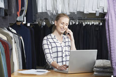 Businesswoman Running On Line Fashion Business On The Phone Stock Photos