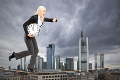 Businesswoman running on a rope in the business center of Frankf Stock Images