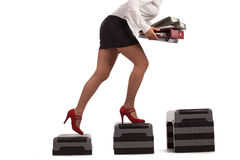 Businesswoman running up with dumbbells Stock Photo