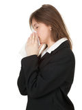 Businesswoman with runny nose and handkerchief Royalty Free Stock Image