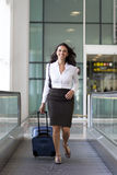 Businesswoman runs at the airport Royalty Free Stock Image