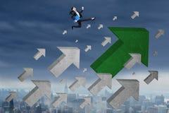 Businesswoman runs over upward arrow Stock Photo