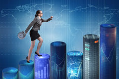 The businesswoman rushing with clock on bar charts Royalty Free Stock Image