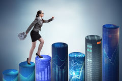 The businesswoman rushing with clock on bar charts Stock Photos
