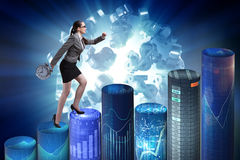 The businesswoman rushing with clock on bar charts Stock Image