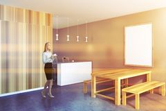 Businesswoman in a rustic kitchen, frame poster stock image