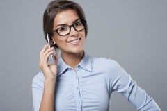 Businesswoman. She`s contacting with her customers by mobilephone Stock Image