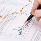 Businesswoman's hand showing diagram Stock Photo