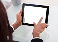 Businesswoman's hands holding digital tablet at desk Stock Photos