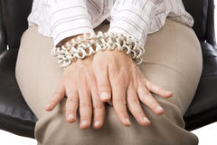 Businesswoman's hands tied. By telephone chord stock image