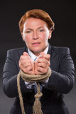 Businesswoman's hands tied up with rope Royalty Free Stock Photos