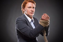 Businesswoman's hands tied up with rope Royalty Free Stock Photography