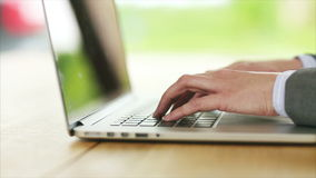 Businesswoman's hands typing on laptop keypad at desk stock footage