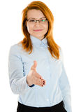 Businesswoman's handshake. Young businesswoman stretching her hand for handshake Stock Images