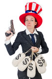 Businesswoman with sacks of money and gun isolated Royalty Free Stock Photography