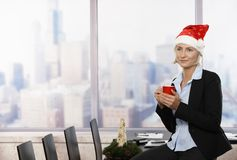 Businesswoman in Santa Claus hat Royalty Free Stock Image