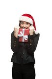 Businesswoman in santa hat holding christmas gift Royalty Free Stock Image