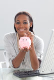 A businesswoman saving money Stock Photos