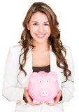 Businesswoman saving money Royalty Free Stock Image