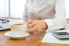 Businesswoman Savoring her morning coffee Royalty Free Stock Photos