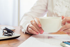 Businesswoman Savoring her morning coffee Stock Photos