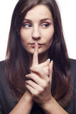 Businesswoman saying shh Stock Images
