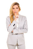 Businesswoman saying shhh Royalty Free Stock Photography