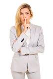 Businesswoman saying shhh Stock Photography
