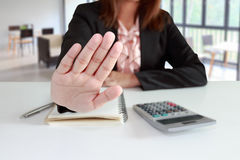Businesswoman says no or hold on at her office Royalty Free Stock Photography
