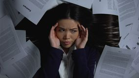 Businesswoman scared of large amount of work, overload and stress concept. Stock footage stock video footage