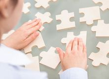 Businesswoman With Scattered Puzzle Stock Image