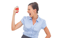 Businesswoman screaming at alarm clock Stock Photo