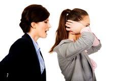 Businesswoman screaming on her partner. Stock Photo