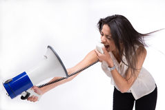 Businesswoman screaming at herself with loudspeaker Stock Images