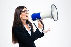 Businesswoman screaming on megaphone Stock Photo
