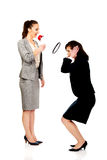 Businesswoman screaming in megaphone. Stock Photo