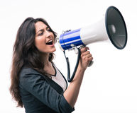 Businesswoman screaming in megaphone Royalty Free Stock Photo