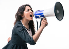 Businesswoman screaming on megaphone Royalty Free Stock Images