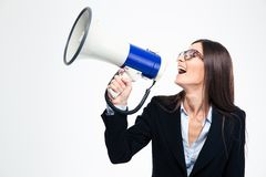 Businesswoman screaming on megaphone Stock Image