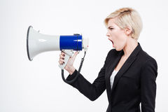 Businesswoman screaming into megaphone Stock Images