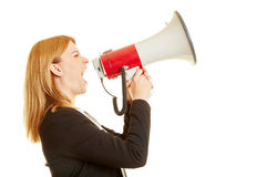 Businesswoman screaming on a megaphone Royalty Free Stock Images