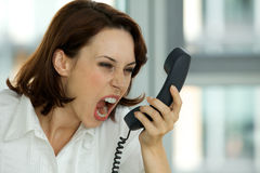 Businesswoman screaming on phone Stock Photos