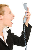 Businesswoman screaming into the phone Royalty Free Stock Image
