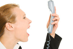 Businesswoman screaming into the phone Stock Images