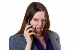 Businesswoman screaming into the phone Stock Photography