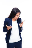 Businesswoman screaming on the phone. Over white background Stock Photography