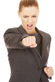 Businesswoman screaming and shaking her fist. royalty free stock photos