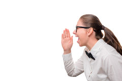 Businesswoman screaming on a white background. To the left a place for an inscription Royalty Free Stock Image