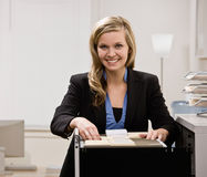 Businesswoman searches through file drawer Royalty Free Stock Photo