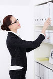 Businesswoman searching files. Royalty Free Stock Photo